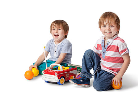 Two small children with a toy car