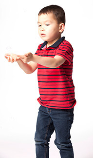 Young kid catching bubbles