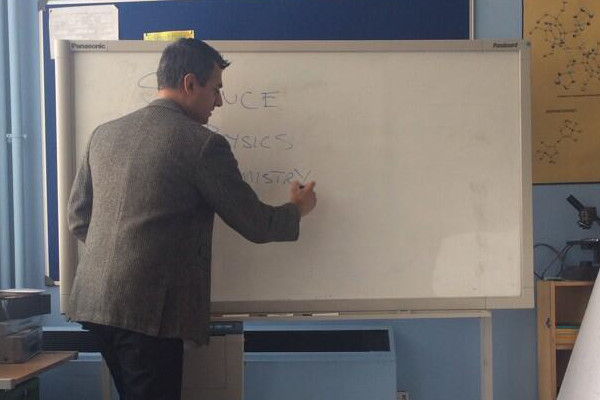 Kal Sabir as Mr Malik at whiteboard.