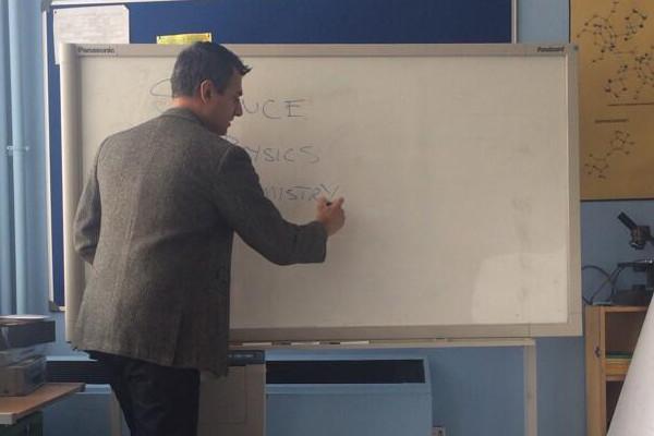 Kal Sabir as Mr Malik at whiteboard.