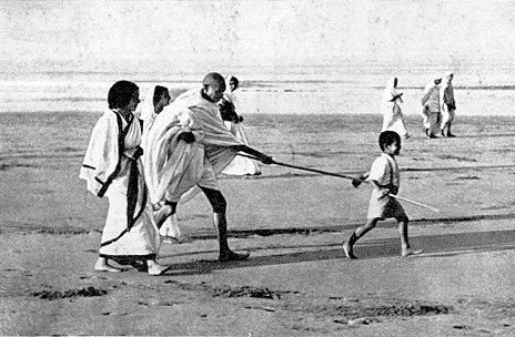Boy Leads Gandhiji on Beach