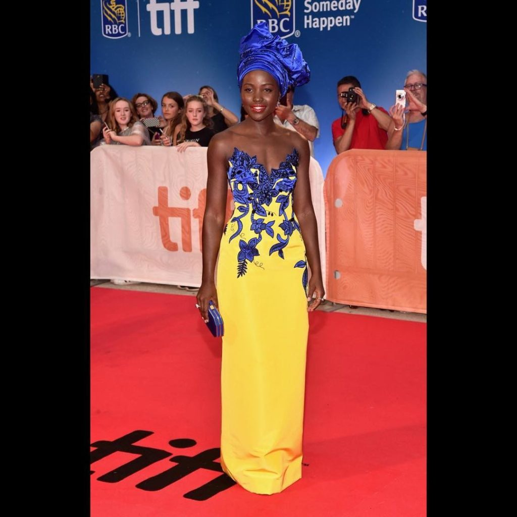 lupita-nyongo-wore-a-carolinaherrera-yellow-blue-embroidered-gown-to-the-queenofkatwe-premiere-during-tiff16