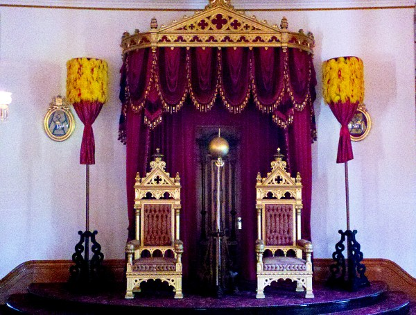 Kahili belonging to Royal Order of Kamehameha I, Hawai'i Chapter 1, on loan to 'iolani Palace, grace the throne room.