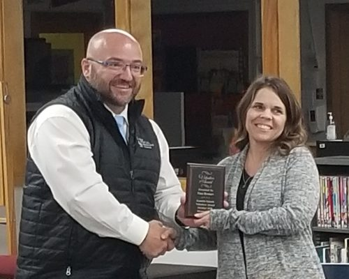 Dr. Merrill presents Tina Brotnov with the Kamiah Cares Volunteer Award