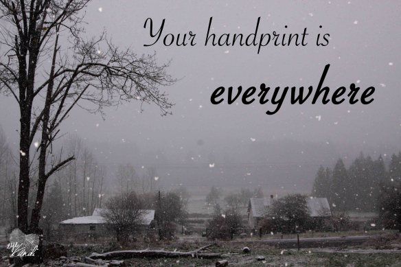 snow falling over a farm with the caption your handprint is everywhere