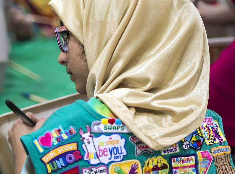 Syeda Khadijah, 10, is running out of room for badges on her Girl Scout vest. She says her troop, made up of Muslim girls, gives her the confidence to be herself in the world.