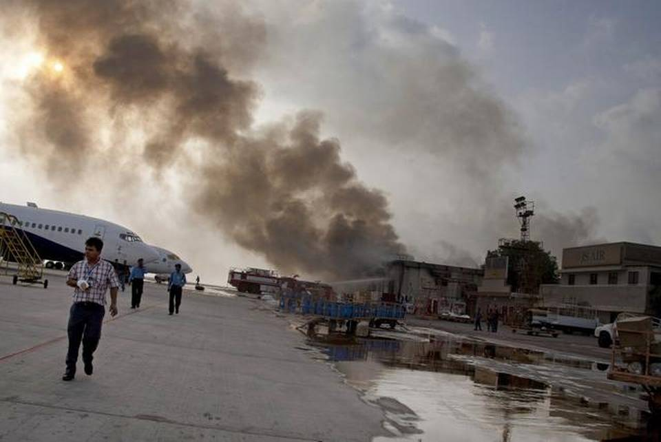 Smoke rises above Jinnah International Airport, where security forces battled militants in Karachi, Pakistan.