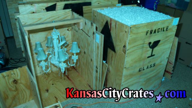 Two Crates With Fine Porcelin Chandeliers Packed Foam Peanuts For Moving