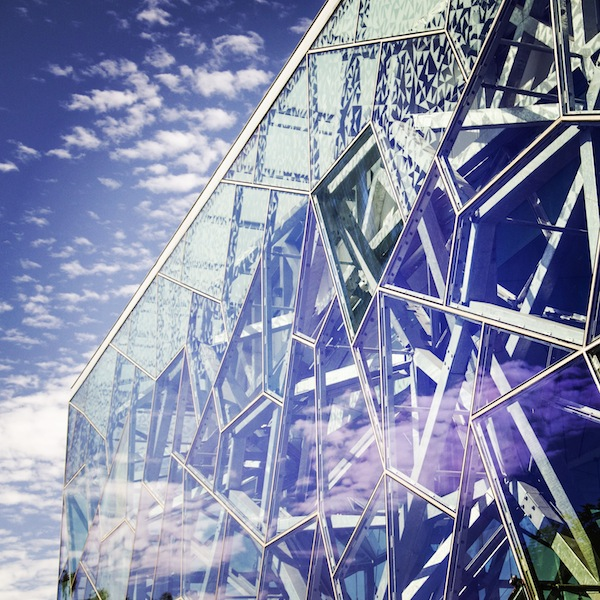 Clouds reflected in the glass of the Deakin Edge Building in Federation Square