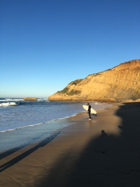 Surfers on the beach at Bells Beach, Torquay, Great Ocean Road