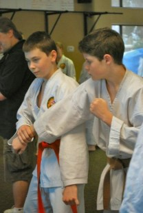 Two of our black belts, back when they were kids, learning tuidi-waza