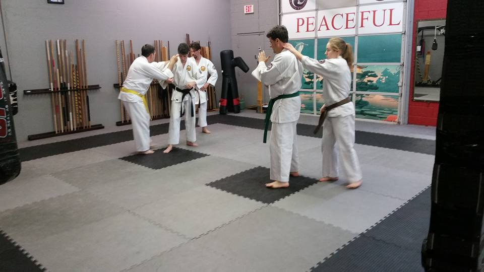 An Adult/Teen karate class at our dojo