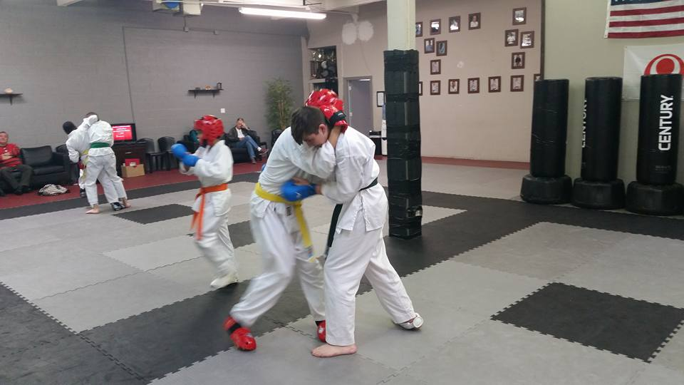 Some teens sparring in our dojo