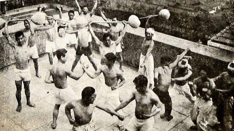 A vintage photo of karateka on Okinawa practicing hojo undo