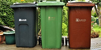 Black brown and green dustbins