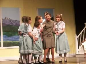 Maria teaches the children to sing.
