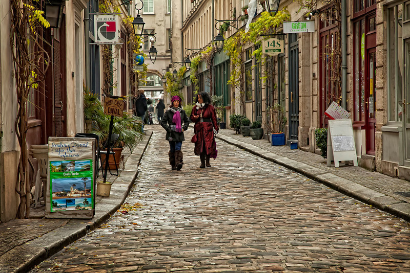 Ladies Who StrollI use the word 'stroll' lightly. Because these particular ladies in the Marais neighborhood of Paris were covering some major groundage. I wondered what they were talking about, so immersed were they. Work? Clothes? Boyfriend? Girlfriend? Working out? Problems of the world? I wondered if they were native Pariesiennes, or if they moved here from another land. And if they were happy there. I admired their fashion sense, as I did most of the women I saw in Paris. Then they swooped by and were gone.