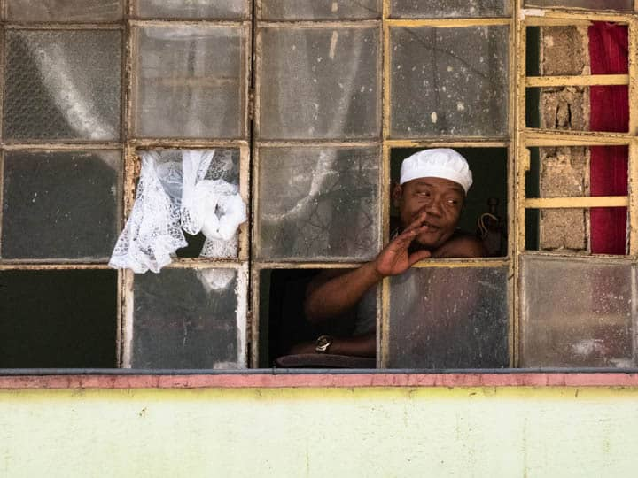 Cuban man looks out of window