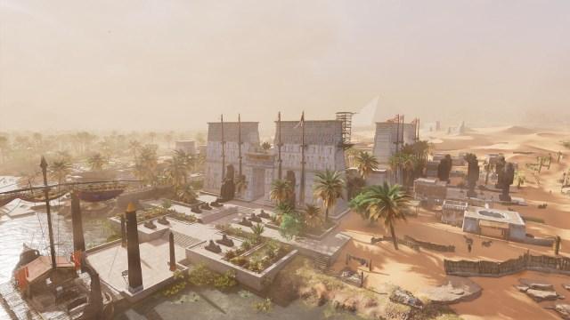 Image décorative : capture du jeu AC Origins, montrant un temple entre le Nil et le désert, avec une pyramide en fond d'image.