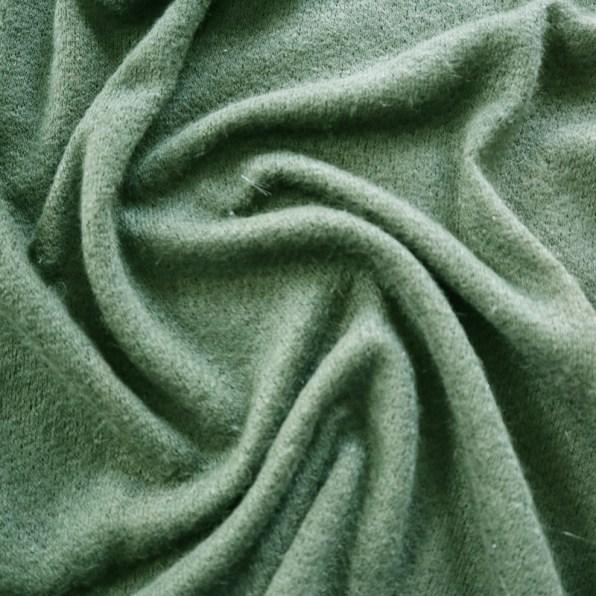 Groene gebreide stof