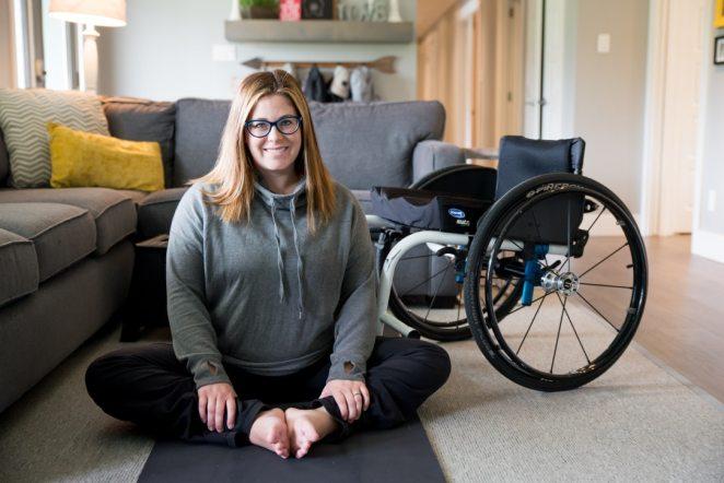 Lady sitting next to wheelchair