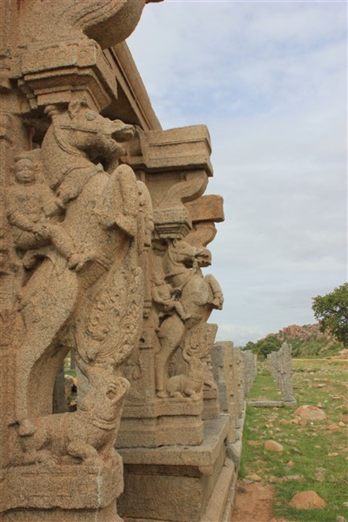 Horse pillars at entrance to water tank in Hampi by Dinesh Kannambadi