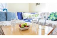 Ferienwohnung-Irene-Wohnzimmer-Sofatisch-mit-Obst-900x600-2571