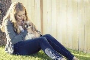 Teenager cuddling a lapdog