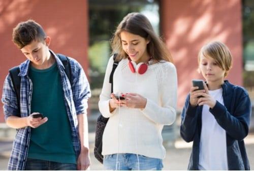 Happy kids on their smartphones