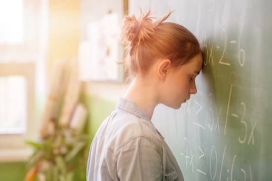 Girl Struggles with Math Dyscalculia