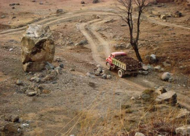 Loot and Plunder: A load carrier truck carrying precious limestone rocks leaves Guryul Ravines -- Photo: Shams Irfan