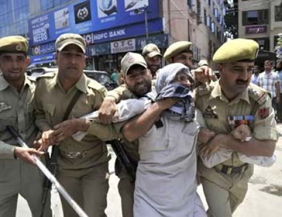 Mushtaq ul Islam being detained by Police before he  could address press in 2012.