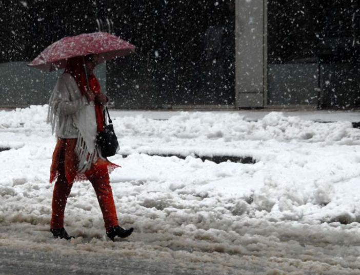 Solitary Walk: A girl walking amid snowfall in Srinagar