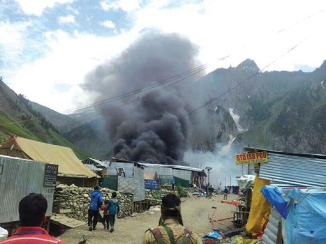 Smoke-billowing-out-from-tents-at--Baltal