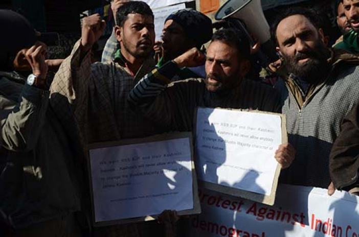 JKLF supporters holding placards in protest against settlement of WP refugees in Srinagar on Friday. Pic: Bilal Bahadur