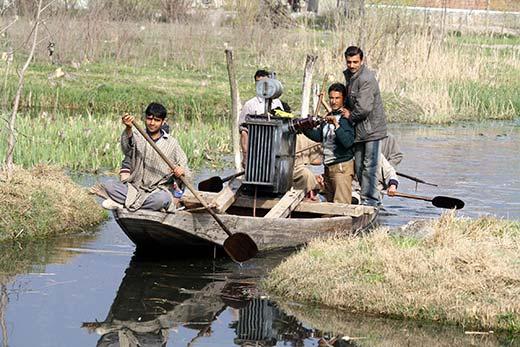 People ferrying transformer on  boat. Pic: Bilal Bahadur