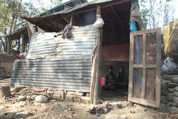 With their house devoured in the diluge, this young couple now lives inside this shed. Pic: Bilal Handoo