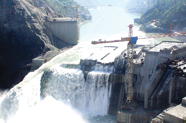Decimated: In August 2005, the once-in-1000-year flood in Chenab overtopped the dam, creating a situation that it led to massive cost and time over-runs.