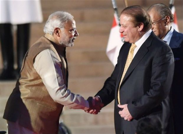 Pakistan premier, Mian Nawaz Sharief, greeting Narendra Modi on his being swore-in as PM of India in New Delhi in 2014.