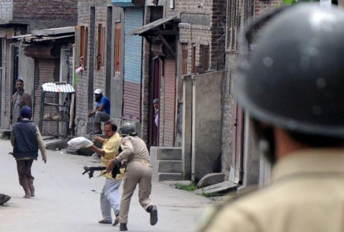 A civilian being beaten up by forces in Batamaloo area of Srinagar on August 30, 2016. (KL Image: Bilal Bahadur)