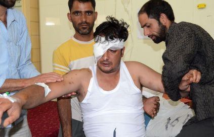 Attendants help Sheraz Ahmad Ahanger at SMHS Hospital Srinagar. He was hit by over hundred pellets fired by forces in Murran Pulwama on Sep 07, 2016.