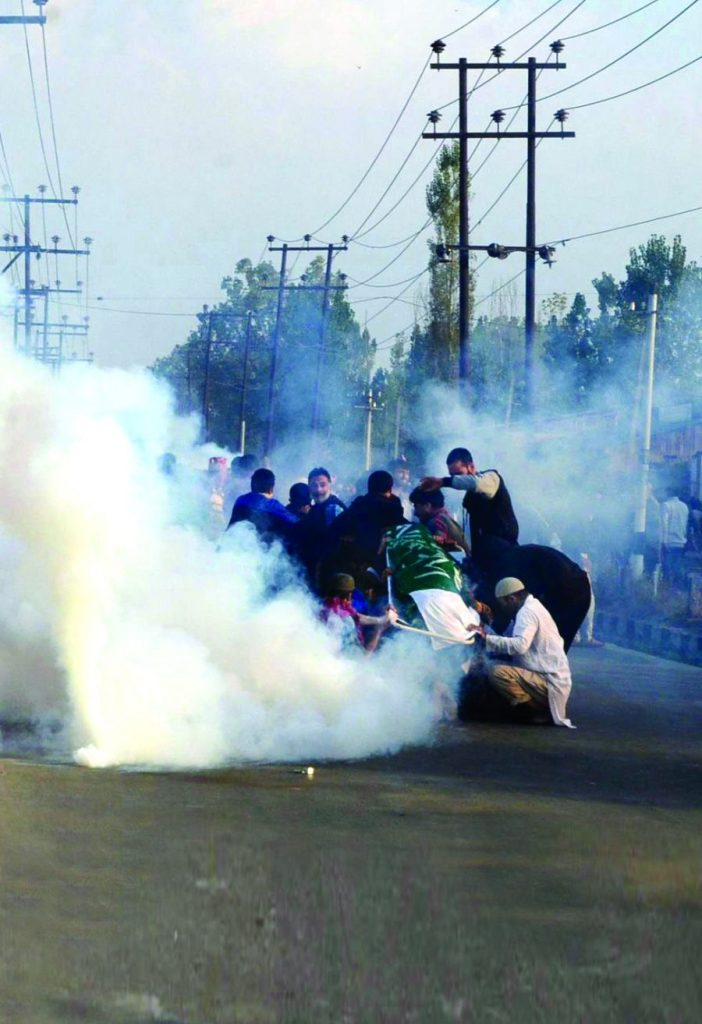 Jammu and Kashmir Police used tear gas shells on the body of a 12-year-old School student, Junaid Ahmad Akhoon, during his funeral procession at Saidapora area of Eidgah in Downtown. (Photo: Bilal Bahadur/KL)