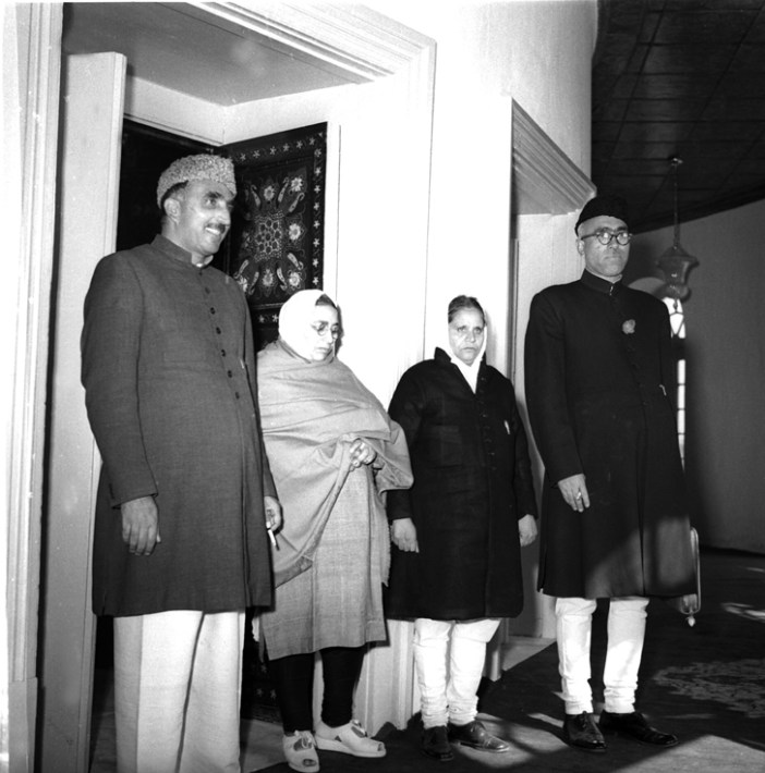 OSD Bamzai/Nov.'51, A31m Sheikh Mohammed Abdullah and Ghulam Mohammed Bakshi with Mrs. Iswari Devi Maini and Mrs. Rajender Singh, women-members of the Kashmir Constituent Assembly. Photograph taken beofre the inauguration of the Assembly in Srinagar on October 31, 1951.