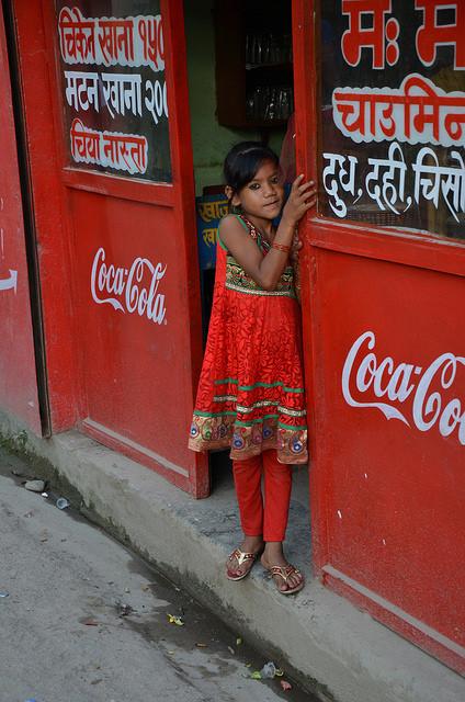 A little girl dressed in red in Kathmandu.