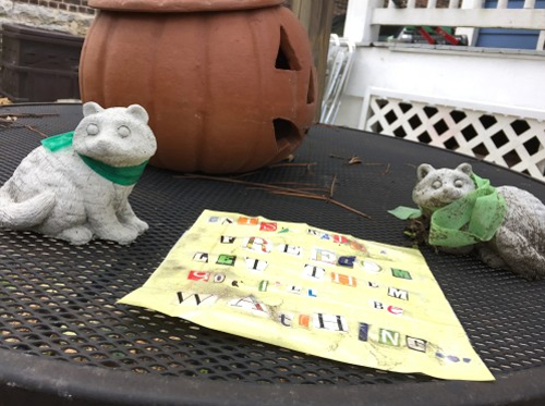 Raccoon statues and a ransom note found in my bacykard.