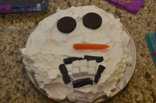 "Okay, so this is probably the worst cake I've ever made. The Snowman looks like he's ready to eat small children. Madeline said, ""That's definitely not your best work,"" and Daddy said I should share a picture of Psycho Snowman on a Pinterest-fail website. Fortunately, you took one bite of the Oreo-cookie-pudding-cake and said, ""This is the best cake ever."" Thank you, sweet girl."