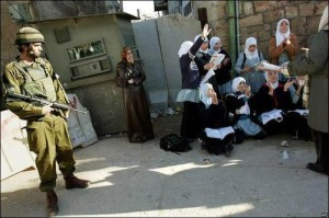 Palestinian girls study on the street in Hebron because soldiers will not let them access their school.