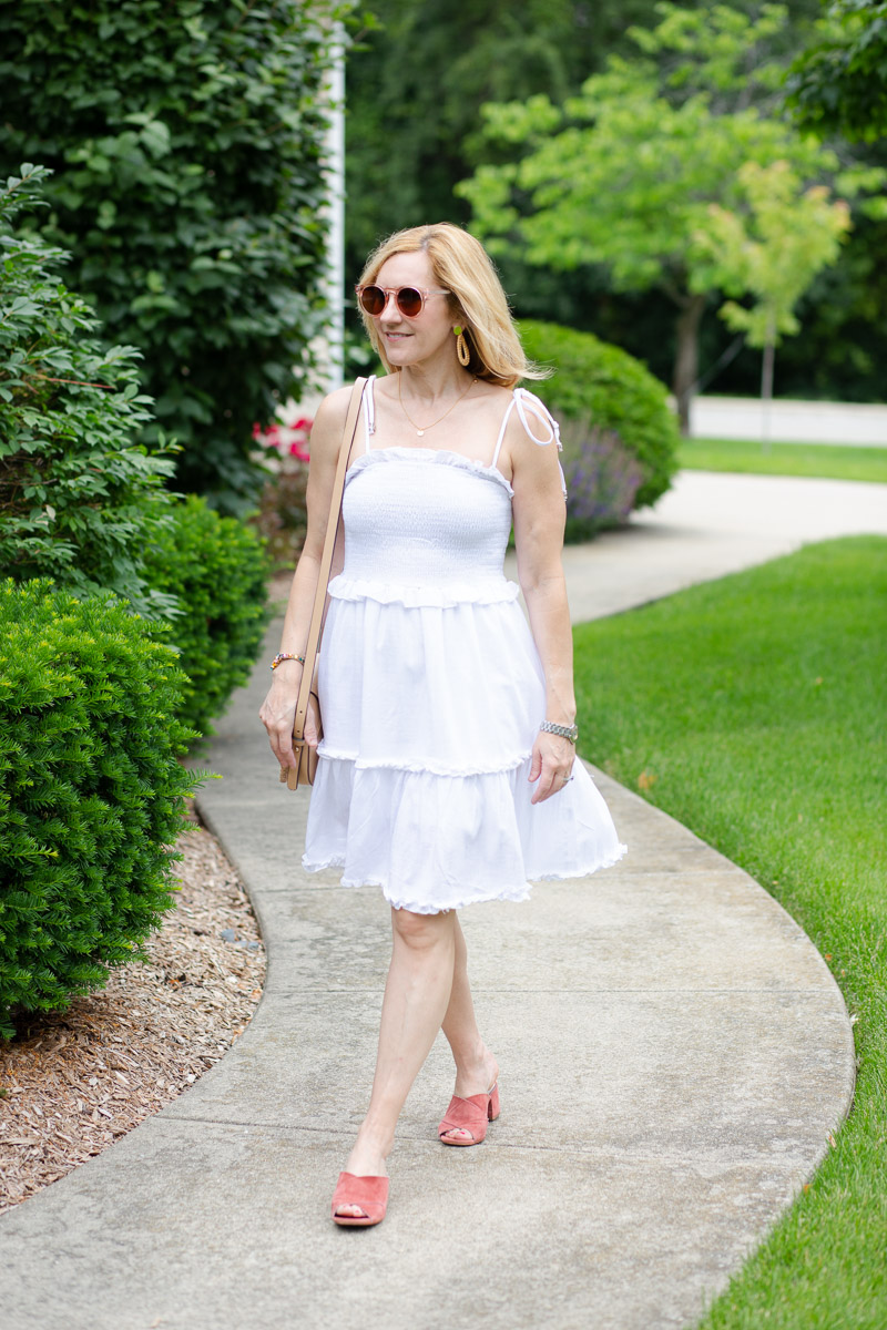 Styling a summer sundress with suede mules.
