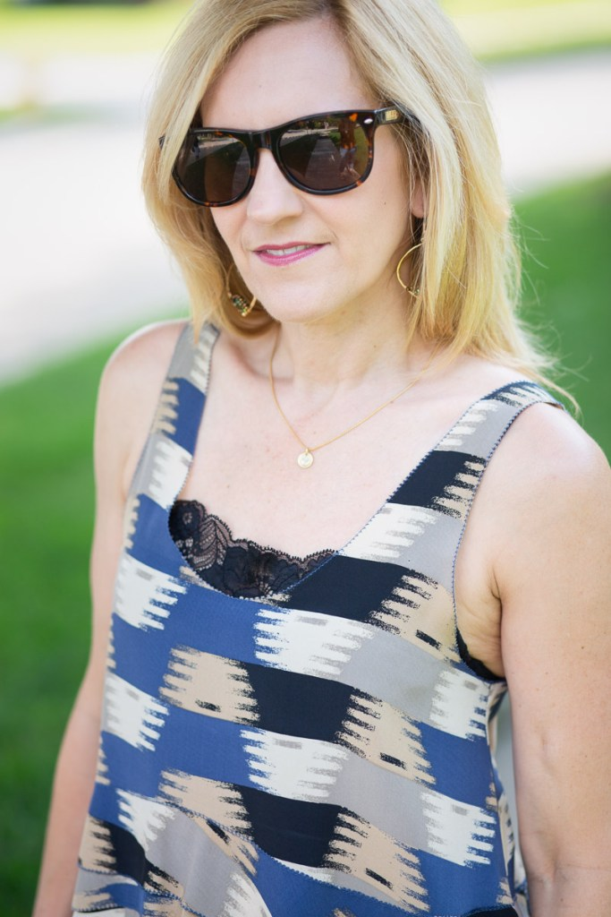 Wearing a printed tank with a black cami bra.