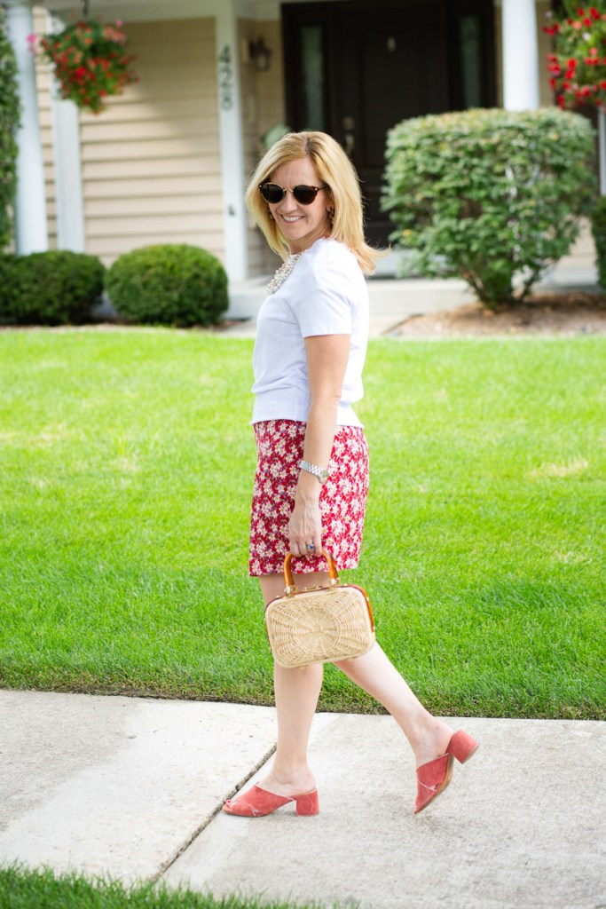 A summer look featuring a white tee with a printed red dress.